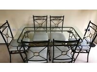 Luxurious Iron & Glass dining table with six chairs and side table to match