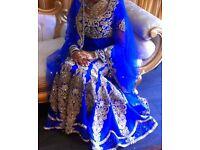Designer bridal dress royal blue from janan store stone work original price £3000.00