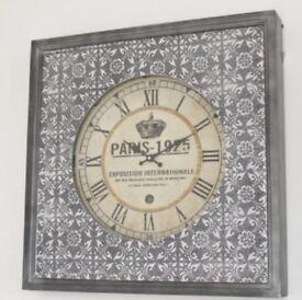 silver embossed clock
