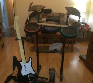 xbox360 rock band with 3 guitar and wireless drums 5 games and m