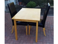 """Oak veneer dining table and 2x """"leather"""" chairs"""