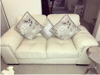 Three seater and two seater cream leather settees