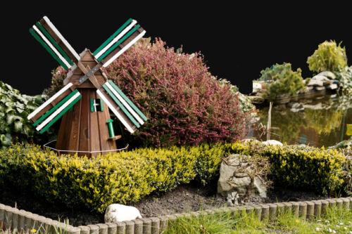 Wie Sie mit Windmühlen und Häusern Ihren Garten dekorieren können
