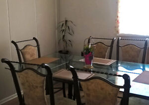 Glass dining table with 6 chairs. Free delivery!