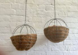 Two spherical / round hanging planters