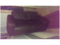 2 x 2 brown leather sofas.