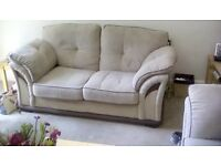 3 seater 2 seater settee in biege with brown detailing and matching pouffe from harveys used
