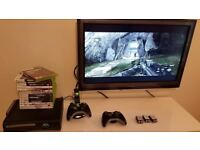 Xbox 360 Black 120GB HDD Console Bundle with 15 top games.
