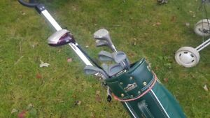 2 sets of Golf clubs with Augusta golf bags and carts.