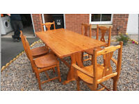 vintage solid pine table and 6 chairs [perfect for a chabby chic project ]