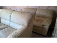 Two Cream Leather 2 Seater Sofas