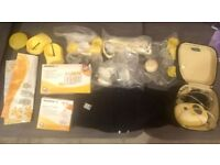 Medela freestyle double electric breast pump with loads of extras including hands free bra