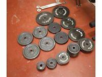 100kg cast iron standard 25mm diameter plates- £1 a kilo.