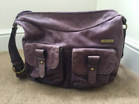 Storksak Emily purple leather changing bag with adjustable shoulder strap