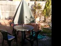 Garden lounge chair and table set with parasol