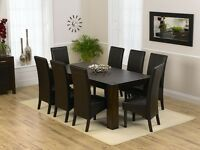 Brown wood dinning table with 6 brown leather chairs