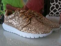 Gold glitter trainers