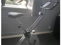 Digital Exercise bike, very good find. Folds away for storage
