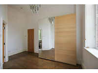 Pair of IKEA sliding doors . Mirrored glass and white oak stained veneer. 200cm wide x 236cm high .