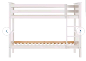 A new still boxed white detachable bunk bed frame.