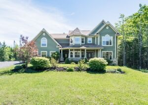 ONE OF A KIND, EXECUTIVE HOME ON 2.64 ACRES IN RURAL ESTATES!