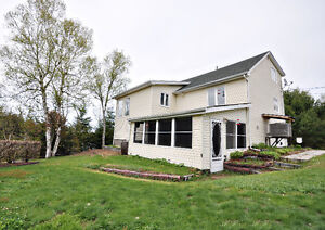 WATERFRONT!!!! 3 bdrs home sitting on 1.96 acres in Ste.Anne!