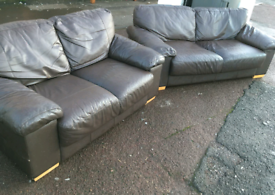 Brown leather settees
