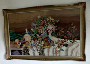 A large antique glass framed needlepoint/tapestry