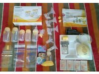 ****Bargain****Medela Swing Breastpump + Breastmilk store and feed set + some extras