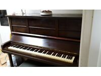 Upright Piano. Iron framed good quality upright piano for sale