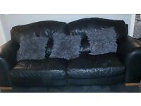 Black leather 3 seater 2 seater and footstool