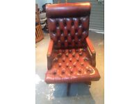 Oxblood leather antique Captains swivel desk chair. Deep button down seat, mahogany.
