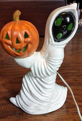 Vintage Ceramic Halloween Ghost carrying pumpkin