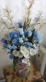 Beautiful silk flowers in vases and pots