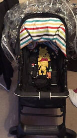 Hauck winnie the pooh pram with attatchable carseat.