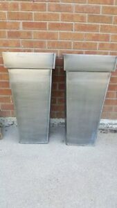 "Large metal planters (aluminum possibly) almost 30"" tall"