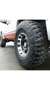 """like new 33"""" tires mounted on Pro Comp wheels"""