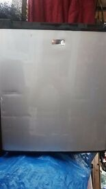 thermoloectric cooler fridge good working order door has a dent in