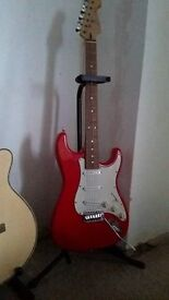 Cruiser by Crafter red electric guitar with stand