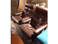 2 retro leather arm chairs.
