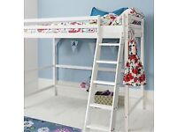 High wooden bed frame