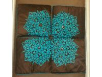 4 brown and blue cushion covers