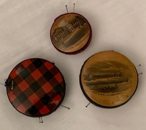 Three antique  19th century Mauchline ware pin cushions.