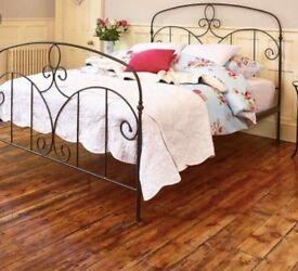 Double black metal bed frame