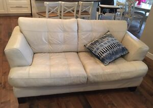 100% Leather sofa and love seat.