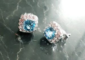 Brand new Blue Topaz and White Sapphire Earrings in Silver