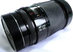 Minolta 28 135mm secret handshake lens.