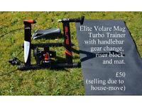 Elite Volare Mag turbo trainer with handlebar gear changer, riser block and mat.