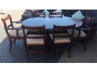 MOHOGANY DINNING TABLE AND CHAIRS