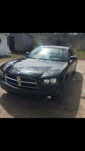 2010 Dodge Charger 7000 or would like to trade for an SUV 4x4
